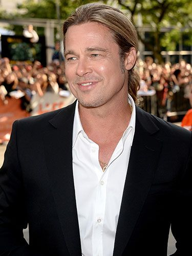 <p>Brad turned up in Toronto, Canada for the Toronto International Film Fest premiere of 12 Years A Slave, which he executive produced. While the film was appropriately praised by critics, we're still finding it a tad difficult to tear our attention away from Brad's handsome suit, sexy smirk, and man-ponytail. Swoon.</p>