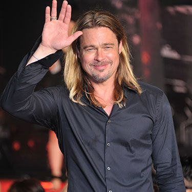 <p>Brad proves that he can pull off absolutely any hairstyle, even long, flowing locks, while out promoting his film World War Z. Is there anything Brad can't do?</p>