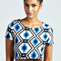 "<p>Get in the summer spirit with a bright and colourful aztec print. This crop top from Boohoo is perfect for injecting some colour into your winter wardrobe. Wear with a high-waisted pencil skirt or high-waisted tailored trousers and give your wardrobe some summer loving.</p> <p>Diamond aztec crop top, £15, <a href=""http://www.boohoo.com/restofworld/looks/aztec/icat/aztec/evening-tops/penny-diamond-aztec-crop-top/invt/azz36429"" target=""_blank"">Boohoo.com</a></p> <p><a href=""http://www.cosmopolitan.co.uk/fashion/news/rihanna-new-face-of-balmain"" target=""_blank"">RIHANNA FOR BALMAIN</a></p> <p><a href=""http://www.cosmopolitan.co.uk/fashion/shopping/christmas-party-dresses-investment"" target=""_blank"">TEN DREAMY PARTY DRESSES</a></p> <p><a href=""http://www.cosmopolitan.co.uk/fashion/news/which-party-dress-colour-works-best"" target=""_blank"">THE BEST COLOURS TO PARTY IN</a></p> <p> </p>"