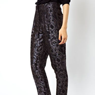 <p>Could these trousers be any more chic? We love the slight sheen, the slight cropped length and the high waisted silhouette, which make for the perfect day-to-night trouser. Pair with black polo neck for day time wearing, or a sheer blouse for drinks in the evening. And don't forget the sky high heels.</p>