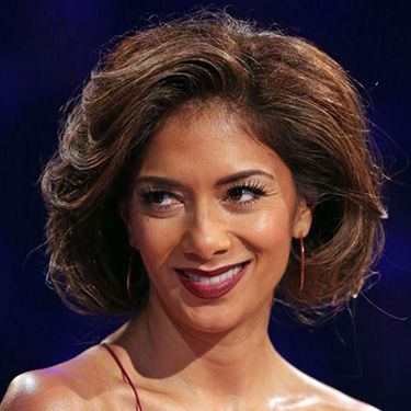 """<p class=""""p1"""">""""The faux bob, as seen on Nicole Scherzinger, is a great look for the party season,' says Gary Ingham, owner of Gary Ingham Lifestyle & Spa in Hampstead. """"You can work this look on most kinds of hair giving you anything from a sleek bob to a curly, voluminous one like Nicole's.""""</p><p class=""""p1"""">Gary gives us the lowdown on how to get this look:  </p><p class=""""p1"""">1. Get some volume into the hair by applying a styling foam to locks, and then using either hot rollers to create big curls. If you don't have rollers, then blow-dry the hair with a large radial brush, clipping each curl to your head until it cools and sets.</p><p class=""""p1"""">2. Once all the barrel curls are in place, apply a liberal amount of firm holding spray and leave to dry (good time to do your makeup!)</p><p class=""""p1"""">3. Take the rollers out and backcomb each section of your hair with a tailcomb. Then use a paddle brush to smooth all the hair down from the top of your head to the ends.</p><p class=""""p1"""">4. Create a loose ponytail at the nape of your neck. If you have graduated layers around your face then let these fall out as it will make the bob look more convincing.</p><p class=""""p1"""">5. Tuck the end of the ponytail under on itself and secure in place with pins. Then gently tease out the ponytail, pulling forwards towards your chin, to create your perfect faux bob!</p><p class=""""p1"""">Gary's star product: Aveda Phomollient Styling Foam, £14.50, <a href=""""http://www.aveda.co.uk/product/5321/17164/Hair-Care/Styling/Phomollient-Styling-Foam/index.tmpl"""" target=""""_blank"""">aveda.co.uk</a></p><p><a href=""""http://www.cosmopolitan.co.uk/beauty-hair/news/styles/celebrity/cosmo-hairstyle-of-the-day"""" target=""""_blank"""">COSMO'S HAIRSTYLE OF THE DAY</a></p><p><a href=""""http://www.cosmopolitan.co.uk/beauty-hair/news/beauty-news/cosmopolitan-beauty-awards-2013-the-winners"""" target=""""_blank"""">COSMO BEAUTY AWARD 2013 WINNERS</a></p><p><a href=""""http://www.cosmopolitan.co.uk/beauty-hair/beauty-tips/beauty-body-treatmen"""