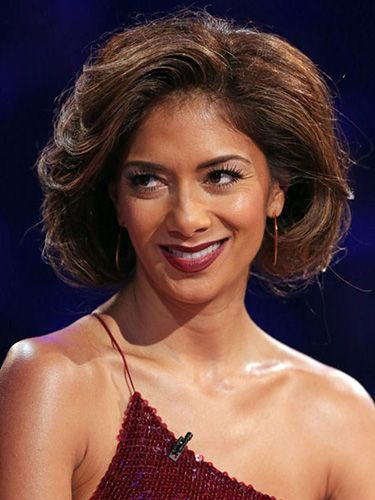 "<p class=""p1"">""The faux bob, as seen on Nicole Scherzinger, is a great look for the party season,' says Gary Ingham, owner of Gary Ingham Lifestyle & Spa in Hampstead. ""You can work this look on most kinds of hair giving you anything from a sleek bob to a curly, voluminous one like Nicole's.""</p> <p class=""p1"">Gary gives us the lowdown on how to get this look:  </p> <p class=""p1"">1. Get some volume into the hair by applying a styling foam to locks, and then using either hot rollers to create big curls. If you don't have rollers, then blow-dry the hair with a large radial brush, clipping each curl to your head until it cools and sets.</p> <p class=""p1"">2. Once all the barrel curls are in place, apply a liberal amount of firm holding spray and leave to dry (good time to do your makeup!)</p> <p class=""p1"">3. Take the rollers out and backcomb each section of your hair with a tailcomb. Then use a paddle brush to smooth all the hair down from the top of your head to the ends.</p> <p class=""p1"">4. Create a loose ponytail at the nape of your neck. If you have graduated layers around your face then let these fall out as it will make the bob look more convincing.</p> <p class=""p1"">5. Tuck the end of the ponytail under on itself and secure in place with pins. Then gently tease out the ponytail, pulling forwards towards your chin, to create your perfect faux bob!</p> <p class=""p1"">Gary's star product: Aveda Phomollient Styling Foam, £14.50, <a href=""http://www.aveda.co.uk/product/5321/17164/Hair-Care/Styling/Phomollient-Styling-Foam/index.tmpl"" target=""_blank"">aveda.co.uk</a></p> <p><a href=""http://www.cosmopolitan.co.uk/beauty-hair/news/styles/celebrity/cosmo-hairstyle-of-the-day"" target=""_blank"">COSMO'S HAIRSTYLE OF THE DAY</a></p> <p><a href=""http://www.cosmopolitan.co.uk/beauty-hair/news/beauty-news/cosmopolitan-beauty-awards-2013-the-winners"" target=""_blank"">COSMO BEAUTY AWARD 2013 WINNERS</a></p> <p><a href=""http://www.cosmopolitan.co.uk/beauty-hair/beauty-tips/beauty-body-treatment-reviews-tried-and-tested-beauty-lab"" target=""_blank"">BEAUTY TREAT OF THE WEEK</a></p>"