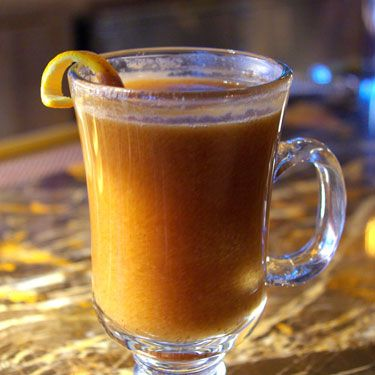 "<p><strong>Ingredients:</strong> <br />15ml Honey <br />1 Knob of unsalted butter <br />50ml Dark Rum <br />Top up with some boiling water <br /><br /><strong>Method:</strong><br /> Place teaspoon loaded with honey in warmed hot toddy glass. Add other ingredients and stir until honey and butter are dissolved. <br /><br /><strong>Garnish:</strong> Cinnamon stick, lemon slice and some grated nutmeg <a href=""http://www.mlkhny.com/"" target=""_blank"">http://www.mlkhny.com/</a></p>
