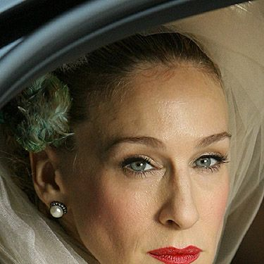 """<p>Sarah Jessica Parker is probably the only person who could make us think wearing a bird in our hair to get married is the best idea ever. Also, we love her red lippie for real movie star style.</p><p><a href=""""http://www.cosmopolitan.co.uk/fashion/news/kaley-cuoco-wedding-dress"""" target=""""_blank"""">KALEY CUOCO'S PINK WEDDING DRESS</a></p><p><a href=""""http://www.cosmopolitan.co.uk/beauty-hair/news/trends/celebrity-beauty/best-wedding-makeup-tips-celebrity-makeup?click=main_sr"""" target=""""_blank"""">WEDDING MAKEUP WE WANT TO COPY</a></p><p><a href=""""http://www.cosmopolitan.co.uk/fashion/shopping/top-ten-wedding-dresses-on-film?click=main_sr"""" target=""""_blank"""">TOP TEN WEDDING DRESSES ON FILM</a></p>"""