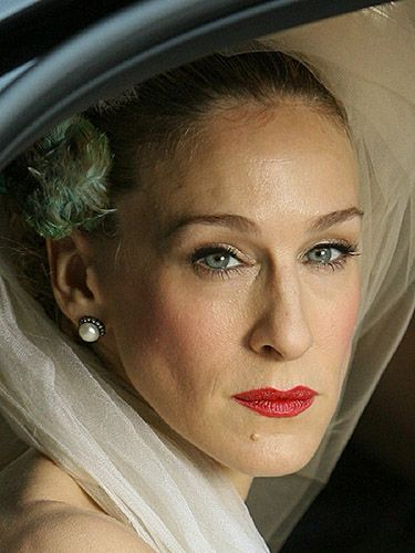 "<p>Sarah Jessica Parker is probably the only person who could make us think wearing a bird in our hair to get married is the best idea ever. Also, we love her red lippie for real movie star style.</p> <p><a href=""http://www.cosmopolitan.co.uk/fashion/news/kaley-cuoco-wedding-dress"" target=""_blank"">KALEY CUOCO'S PINK WEDDING DRESS</a></p> <p><a href=""http://www.cosmopolitan.co.uk/beauty-hair/news/trends/celebrity-beauty/best-wedding-makeup-tips-celebrity-makeup?click=main_sr"" target=""_blank"">WEDDING MAKEUP WE WANT TO COPY</a></p> <p><a href=""http://www.cosmopolitan.co.uk/fashion/shopping/top-ten-wedding-dresses-on-film?click=main_sr"" target=""_blank"">TOP TEN WEDDING DRESSES ON FILM</a></p>"