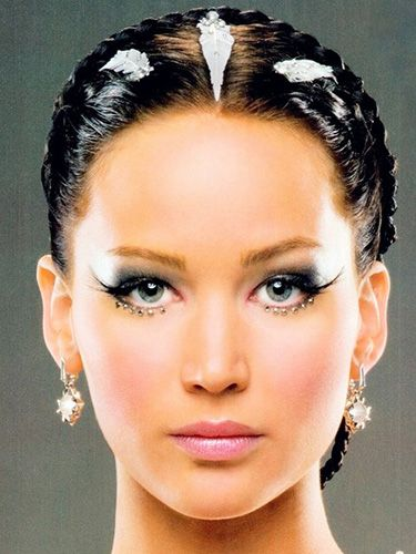 "<p>Not everyone wants to go subtle with their wedding day makeup. The Katniss Everdeen bridal look features smokey eyes, bold flicks and jewels stuck along the lower lashline -  plus silver-leafed, wet look hair. One for the brave!</p> <p><a href=""http://www.cosmopolitan.co.uk/fashion/news/kaley-cuoco-wedding-dress"" target=""_blank"">KALEY CUOCO'S PINK WEDDING DRESS</a></p> <p><a href=""http://www.cosmopolitan.co.uk/beauty-hair/news/trends/celebrity-beauty/best-wedding-makeup-tips-celebrity-makeup?click=main_sr"" target=""_blank"">WEDDING MAKEUP WE WANT TO COPY</a></p> <p><a href=""http://www.cosmopolitan.co.uk/fashion/shopping/top-ten-wedding-dresses-on-film?click=main_sr"" target=""_blank"">TOP TEN WEDDING DRESSES ON FILM</a></p>"