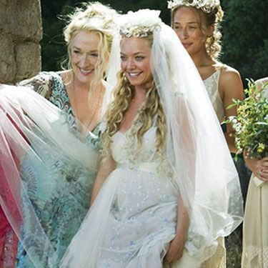 <p>Yep, this was the dress that made us all want to get married on a Greek Island. Combined with Amanda Seyfried's enviable tan and amazing wedding hair, we wouldn't mind recreating this look.</p>