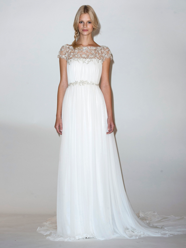 "<p>Lace sleeves on wedding dresses are nothing new, ever since a certain Ms Middleton got hitched in Sarah Burton for McQueen, but lengths vary for summer 2014, ranging from full coverage through to cute caps.<em><br /></em></p> <p><em><< As seen at: <strong>Marchesa</strong></em></p> <p><a href=""http://www.cosmopolitan.co.uk/fashion/shopping/spring-fashion-trends-2014"" target=""_blank"">The BIG spring fashion trends for 2014</a></p> <p><a href=""http://www.cosmopolitan.co.uk/fashion/shopping/top-ten-wedding-dresses-on-film"" target=""_blank"">10 best wedding dresses from films</a></p> <p><a href=""http://www.cosmopolitan.co.uk/fashion/news/"" target=""_blank"">Get the latest fashion and style news</a></p>"