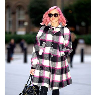 """<p>Fearne Cotton shows that you don't have to give up your colourful side to dress for winter in this vibrant pink and monochrome coat. Nice matching hair!</p><p><a href=""""http://www.cosmopolitan.co.uk/fashion/shopping/primark-summer-fashion-trends-2014"""" target=""""_blank"""">PRIMARK'S SPRING FASHION COLLECTION</a></p><p><a href=""""http://www.cosmopolitan.co.uk/fashion/love/love-it-or-loathe-it-daisy-lowe-winter-floral-dress"""" target=""""_blank"""">LOVE IT OR LOATHE IT: DAISY LOWE</a></p><p><a href=""""http://www.cosmopolitan.co.uk/fashion/shopping/womens-clothing-under-ten-pounds"""" target=""""_blank"""">DAILY FASHION FIX: UNDER A TENNER</a></p>"""