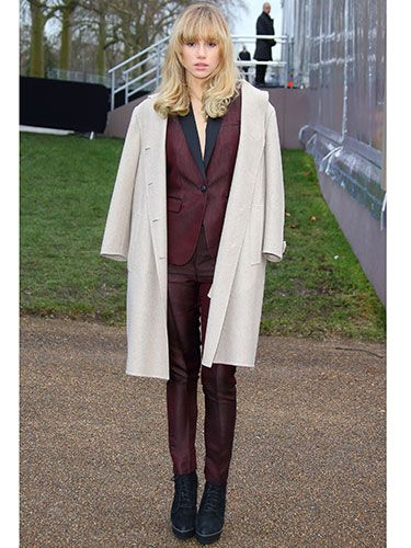 "<p>Has someone explained how the armholes on a coat work to Suki? Obviously we're joking, the drape is THE way to wear a coat, and anyway she can do whatever she wants because SHE'S THE ONE KISSING BRADLEY COOPER.</p> <p><a href=""http://www.cosmopolitan.co.uk/fashion/shopping/primark-summer-fashion-trends-2014"" target=""_blank"">PRIMARK'S SPRING FASHION COLLECTION</a></p> <p><a href=""http://www.cosmopolitan.co.uk/fashion/love/love-it-or-loathe-it-daisy-lowe-winter-floral-dress"" target=""_blank"">LOVE IT OR LOATHE IT: DAISY LOWE</a></p> <p><a href=""http://www.cosmopolitan.co.uk/fashion/shopping/womens-clothing-under-ten-pounds"" target=""_blank"">DAILY FASHION FIX: UNDER A TENNER</a></p>"