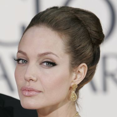 <p>Ange's feline eyes and bee-stung pout are iconic beauty features, and she enhanced them so artistically here in 2007. And her jumbo ballerina bun? Very sexy indeed.</p>