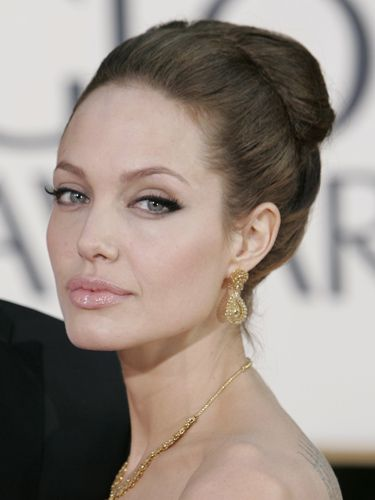"<p>Ange's feline eyes and bee-stung pout are iconic beauty features, and she enhanced them so artistically here in 2007. And her jumbo ballerina bun? Very sexy indeed.</p> <p><a href=""http://www.cosmopolitan.co.uk/beauty-hair/news/styles/celebrity/cosmo-hairstyle-of-the-day"" target=""_self"">COSMO'S HAIRSTYLE OF THE DAY</a></p> <p><a href=""http://www.cosmopolitan.co.uk/beauty-hair/news/styles/hair-trends-spring-summer-2014"" target=""_self"">THE HOTTEST HAIR TRENDS FOR 2014</a></p> <p><a href=""http://www.cosmopolitan.co.uk/beauty-hair/news/trends/celebrity-beauty/"" target=""_blank"">THE LATEST CELEBRITY BEAUTY NEWS</a></p>"