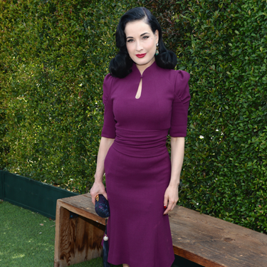 """<p>Basically, Dita von Teese can do no wrong - and this purple Carolina Herrera dress is no exception, showcasing that infamous weeny waist a treat. Styled with matching Loubs and her trademark red lips, our love affair with DVT is still going strong.</p><p><a href=""""http://www.cosmopolitan.co.uk/fashion/love/"""" target=""""_blank"""">VOTE ON CELEBRITY STYLE</a></p><p><a href=""""http://www.cosmopolitan.co.uk/fashion/shopping/womens-clothing-under-ten-pounds"""" target=""""_blank"""">SHOP WOMEN'S FASHION FOR £10 OR LESS</a></p><p><a href=""""http://www.cosmopolitan.co.uk/fashion/celebrity/"""" target=""""_blank"""">SEE THE LATEST CELEBRITY TRENDS</a></p>"""