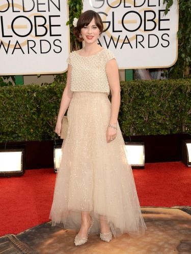 "<p>Zooey Deschanel has gone for a soft, romantic look in this floaty Oscar de la Renta dress. We love her low chignon complete with white rose. Beautiful!</p> <p><a href=""http://www.cosmopolitan.co.uk/beauty-hair/news/trends/celebrity-beauty/best-golden-globes-hair-makeup-beauty"" target=""_blank"">BEST GOLDEN GLOBES BEAUTY EVER</a></p> <p><a href=""http://www.cosmopolitan.co.uk/fashion/celebrity/best-golden-globes-dresses-ever"" target=""_blank"">REMEMBER THESE GOLDEN GLOBES DRESSES?</a></p> <p><a href=""http://www.cosmopolitan.co.uk/fashion/celebrity/best-dressed-celebrities-10-january"" target=""_blank"">THIS WEEK'S BEST DRESSED CELEBRITIES</a></p>"