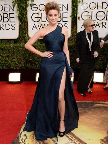 "<p>Is Amber Heard trying to steal Angelina's leg trick?! She's teamed a navy Versace gown with the biggest quiff ever seen to man...</p> <p><a href=""http://www.cosmopolitan.co.uk/beauty-hair/news/trends/celebrity-beauty/best-golden-globes-hair-makeup-beauty"" target=""_blank"">BEST GOLDEN GLOBES BEAUTY EVER</a></p> <p><a href=""http://www.cosmopolitan.co.uk/fashion/celebrity/best-golden-globes-dresses-ever"" target=""_blank"">REMEMBER THESE GOLDEN GLOBES DRESSES?</a></p> <p><a href=""http://www.cosmopolitan.co.uk/fashion/celebrity/best-dressed-celebrities-10-january"" target=""_blank"">THIS WEEK'S BEST DRESSED CELEBRITIES</a></p>"