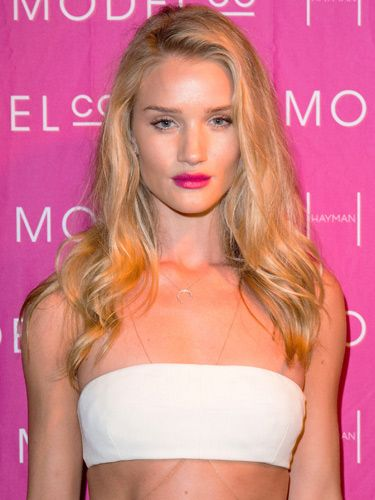 """<p>To make your pout pop, go for a hot pink like model Rosie Huntington-Whiteley. Simply pair it with brushed-up brows and a slick of mascara to keep things classy not brassy. <br /> <br />As the face of Model Co, we suspect Rosie is wearing the <a href=""""http://www.modelcocosmetics.com/shop/party-proof-lipstick"""" target=""""_blank"""">Party Proof Lipstick</a> in Pink Sequin (£16.95) which won't budge – even if you're locking lips.</p>"""