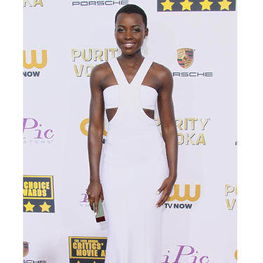 """<p>Lupita Nyong'o is the name on everyone's lips, and she has fast become a red carpet fashion fave. The Kenyan actress picked up the Best Supporting Actress award at the 2014 Critics' Choice Awards looked stunning in a white custom Calvin Klein Collection dress.</p><p><strong>More red carpet fashion</strong></p><p><a href=""""Golden%20Globes%202014:%20Top%20fashion%20trends%20on%20the%20red%20carpet%20%20Read%20more:%20http:/www.cosmopolitan.co.uk/fashion/news/golden-globes-2014-fashion-trends"""" target=""""_blank"""">Top fashion trends from the Golden Globes 2014</a></p><p><a href=""""http://www.cosmopolitan.co.uk/fashion/celebrity/best-golden-globes-dresses-ever"""" target=""""_blank"""">Best ever Golden Globes dresses from the 90s and beyond</a></p><p><a href=""""http://www.cosmopolitan.co.uk/fashion/celebrity/"""" target=""""_blank"""">Get the latest celebrity style news</a></p>"""