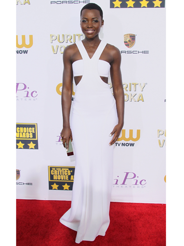 "<p>Lupita Nyong'o is the name on everyone's lips, and she has fast become a red carpet fashion fave. The Kenyan actress picked up the Best Supporting Actress award at the 2014 Critics' Choice Awards looked stunning in a white custom Calvin Klein Collection dress.</p> <p><strong>More red carpet fashion</strong></p> <p><a href=""Golden%20Globes%202014:%20Top%20fashion%20trends%20on%20the%20red%20carpet%20%20Read%20more:%20http:/www.cosmopolitan.co.uk/fashion/news/golden-globes-2014-fashion-trends"" target=""_blank"">Top fashion trends from the Golden Globes 2014</a></p> <p><a href=""http://www.cosmopolitan.co.uk/fashion/celebrity/best-golden-globes-dresses-ever"" target=""_blank"">Best ever Golden Globes dresses from the 90s and beyond</a></p> <p><a href=""http://www.cosmopolitan.co.uk/fashion/celebrity/"" target=""_blank"">Get the latest celebrity style news</a></p>"