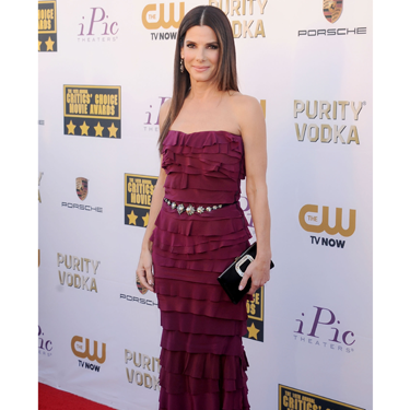 """<p>Sandra Bullock has found her fashion feet on the red carpet, busting out look after look! She wore a (custom made) ruffled raspberry Lanvin gown with a studded leather belt and Roger Vivier clutch. We 're enjoying seeing sultry Sandra!</p><p><strong>More red carpet fashion</strong></p><p><a href=""""Golden%20Globes%202014:%20Top%20fashion%20trends%20on%20the%20red%20carpet%20%20Read%20more:%20http://www.cosmopolitan.co.uk/fashion/news/golden-globes-2014-fashion-trends"""" target=""""_blank"""">Top fashion trends from the Golden Globes 2014</a></p><p><a href=""""http://www.cosmopolitan.co.uk/fashion/celebrity/best-golden-globes-dresses-ever"""" target=""""_blank"""">Best ever Golden Globes dresses from the 90s and beyond</a></p><p><a href=""""http://www.cosmopolitan.co.uk/fashion/celebrity/"""" target=""""_blank"""">Get the latest celebrity style news</a></p>"""