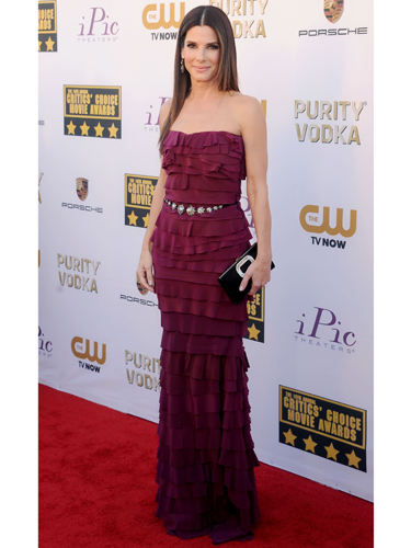 "<p>Sandra Bullock has found her fashion feet on the red carpet, busting out look after look! She wore a (custom made) ruffled raspberry Lanvin gown with a studded leather belt and Roger Vivier clutch. We 're enjoying seeing sultry Sandra!</p> <p><strong>More red carpet fashion</strong></p> <p><a href=""Golden%20Globes%202014:%20Top%20fashion%20trends%20on%20the%20red%20carpet%20%20Read%20more:%20http://www.cosmopolitan.co.uk/fashion/news/golden-globes-2014-fashion-trends"" target=""_blank"">Top fashion trends from the Golden Globes 2014</a></p> <p><a href=""http://www.cosmopolitan.co.uk/fashion/celebrity/best-golden-globes-dresses-ever"" target=""_blank"">Best ever Golden Globes dresses from the 90s and beyond</a></p> <p><a href=""http://www.cosmopolitan.co.uk/fashion/celebrity/"" target=""_blank"">Get the latest celebrity style news</a></p>"