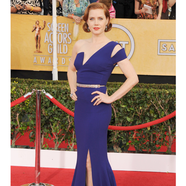 """<p>The American Hustle actress wore a bright blue Antonio Berardi gown with a sharp asymmetrical bodice which, to go all fashwan on you, contrasted nicely with the soft curves of her rolled hairstyle.</p><p><a href=""""http://www.cosmopolitan.co.uk/fashion/celebrity/critics-choice-awards-2014-best-dressed"""" target=""""_blank"""">CRITCS' CHOICE AWARDS 2014: BEST DRESSED</a></p><p><a href=""""http://www.cosmopolitan.co.uk/fashion/celebrity/lupita-nyongo-who-is-she"""" target=""""_blank"""">WHO'S THAT GIRL: LUPITA NYONG'O</a></p><p><a href=""""http://www.cosmopolitan.co.uk/fashion/love/"""" target=""""_blank"""">VOTE ON CELEBRITY STYLE</a></p><div style=""""overflow: hidden&#x3B; color: #000000&#x3B; background-color: #ffffff&#x3B; text-align: left&#x3B; text-decoration: none&#x3B;""""> </div>"""