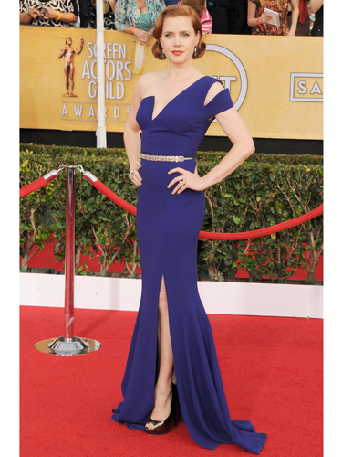 "<p>The American Hustle actress wore a bright blue Antonio Berardi gown with a sharp asymmetrical bodice which, to go all fashwan on you, contrasted nicely with the soft curves of her rolled hairstyle.</p> <p><a href=""http://www.cosmopolitan.co.uk/fashion/celebrity/critics-choice-awards-2014-best-dressed"" target=""_blank"">CRITCS' CHOICE AWARDS 2014: BEST DRESSED</a></p> <p><a href=""http://www.cosmopolitan.co.uk/fashion/celebrity/lupita-nyongo-who-is-she"" target=""_blank"">WHO'S THAT GIRL: LUPITA NYONG'O</a></p> <p><a href=""http://www.cosmopolitan.co.uk/fashion/love/"" target=""_blank"">VOTE ON CELEBRITY STYLE</a></p> <div style=""overflow: hidden; color: #000000; background-color: #ffffff; text-align: left; text-decoration: none;""> </div>"