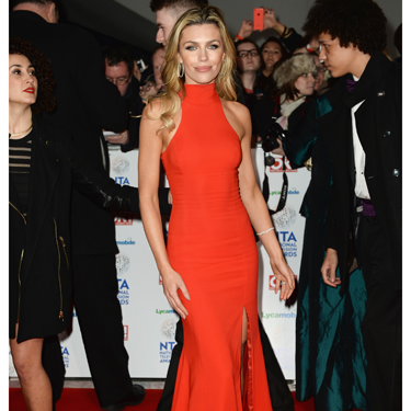 <p>Abbey Clancy looked AMAZING on the NTAs red carpet. Wearing a bright orange dress by Philip Armstrong, complete with thigh high split, Abbey looked like a modern-day Jessica Rabbit. SEXUAL.</p>