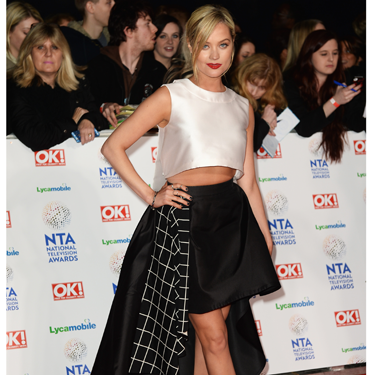 <p>Now THIS is a fashion forward look from Laura Whitmore! Her LA Mania dress ticks looads of spring fashion trends - monochrome and midriffs being the main ones. With the striking stepped hem and grid-like lining, it's the fashion equivalent to TRON. Well played, Whitmore.</p>