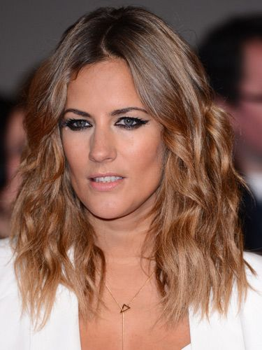"<p>Caroline's tresses were textured with kinky waves yet polished to perfection for their camera close-up. Her sharp feline liner looked perfect against her all-white outfit.</p> <p><a href=""http://www.cosmopolitan.co.uk/beauty-hair/news/styles/celebrity/sexy-date-night-hairstyle-ideas"" target=""_blank"">14 DATE HAIRSTYLE IDEAS</a></p> <p><a href=""http://www.cosmopolitan.co.uk/beauty-hair/news/styles/celebrity/cosmo-hairstyle-of-the-day"" target=""_self"">CELEB HAIRSTYLE OF THE DAY</a></p> <p><a href=""http://www.cosmopolitan.co.uk/beauty-hair/news/styles/hair-trends-spring-summer-2014"" target=""_blank"">HUGE HAIR TRENDS FOR 2014</a></p>"