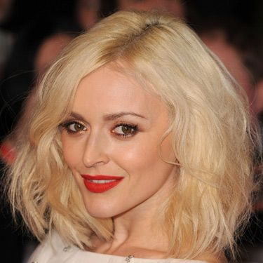 """<p>Fearne's new ice blonde hair looked seriously striking jujjed-up with texture. Her coral-red lipstick brightened her complexion and we loved the rose gold eye makeup.</p><p><a href=""""http://www.cosmopolitan.co.uk/beauty-hair/news/styles/celebrity/sexy-date-night-hairstyle-ideas"""" target=""""_blank"""">14 DATE HAIRSTYLE IDEAS</a></p><p><a href=""""http://www.cosmopolitan.co.uk/beauty-hair/news/styles/celebrity/cosmo-hairstyle-of-the-day"""" target=""""_self"""">CELEB HAIRSTYLE OF THE DAY</a></p><p><a href=""""http://www.cosmopolitan.co.uk/beauty-hair/news/styles/hair-trends-spring-summer-2014"""" target=""""_blank"""">HUGE HAIR TRENDS FOR 2014</a></p>"""