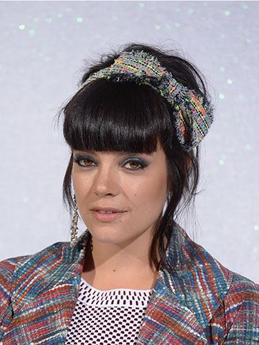"<p>Lily Allen is bringing back the headband, and appropriately she donned a Chanel tweed bow in her hair at the label's Couture show last week in Paris. This is messy-chic at its best.</p> <p><a href=""http://www.cosmopolitan.co.uk/beauty-hair/news/styles/celebrity/sexy-date-night-hairstyle-ideas"" target=""_blank"">14 DATE HAIRSTYLE IDEAS</a></p> <p><a href=""http://www.cosmopolitan.co.uk/beauty-hair/news/styles/celebrity/cosmo-hairstyle-of-the-day"" target=""_self"">CELEB HAIRSTYLE OF THE DAY</a></p> <p><a href=""http://www.cosmopolitan.co.uk/beauty-hair/news/styles/hair-trends-spring-summer-2014"" target=""_blank"">HUGE HAIR TRENDS FOR 2014</a></p>"