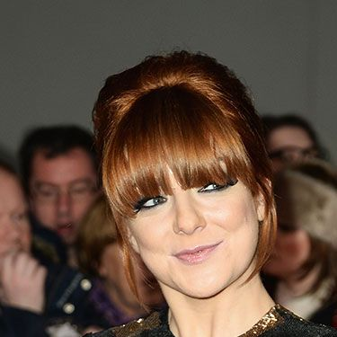 """<p>Could we love Sheridan's fierce new hair colour anymore? Looking super healthy, her new red locks and thick fringe make for a radical New Year update.</p><p><a href=""""http://www.cosmopolitan.co.uk/beauty-hair/news/styles/celebrity/sexy-date-night-hairstyle-ideas"""" target=""""_blank"""">14 DATE HAIRSTYLE IDEAS</a></p><p><a href=""""http://www.cosmopolitan.co.uk/beauty-hair/news/styles/celebrity/cosmo-hairstyle-of-the-day"""" target=""""_self"""">CELEB HAIRSTYLE OF THE DAY</a></p><p><a href=""""http://www.cosmopolitan.co.uk/beauty-hair/news/styles/hair-trends-spring-summer-2014"""" target=""""_blank"""">HUGE HAIR TRENDS FOR 2014</a></p>"""