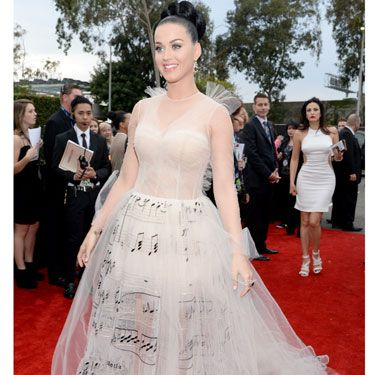 """<p>Katy Perry bloody loves a theme doesn't she? We're big fans of her musical Valentino frock. BIG. But what do you think?</p><p><a href=""""http://www.cosmopolitan.co.uk/celebs/entertainment/grammys-2014-watch-live-red-carpet-coverage"""" target=""""_blank"""">WATCH THE 2014 GRAMMYS RED CARPET **LIVE** HERE</a></p><p><a href=""""http://www.cosmopolitan.co.uk/celebs/entertainment/celebs-at-grammy-awards-2012-entertainment"""" target=""""_blank"""">GRAMMYS 2012: ALL THE CELEBRITIES AND A LOT OF KATY PERRY'S HAIR</a></p><p><a href=""""http://www.cosmopolitan.co.uk/fashion/news/golden-globes-red-carpet-dresses?click=main_sr"""" target=""""_blank"""">ALL THE DRESSES AT THE 2014 GOLDEN GLOBES</a></p><p><a href=""""http://www.cosmopolitan.co.uk/fashion/news/golden-globes-2014-fashion-trends?click=main_sr"""" target=""""_blank"""">5 HOT FASHION TRENDS ON THE GOLDEN GLOBES RED CARPET 2014</a></p>"""