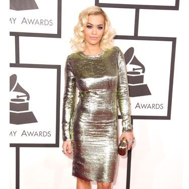"""<p>YES another star in shimmery gold! This makes us REALLY HAPPY on a red carpet. We don't know why.</p><p><a href=""""http://www.cosmopolitan.co.uk/celebs/entertainment/grammys-2014-watch-live-red-carpet-coverage"""" target=""""_blank"""">WATCH THE 2014 GRAMMYS RED CARPET **LIVE** HERE</a></p><p><a href=""""http://www.cosmopolitan.co.uk/celebs/entertainment/celebs-at-grammy-awards-2012-entertainment"""" target=""""_blank"""">GRAMMYS 2012: ALL THE CELEBRITIES AND A LOT OF KATY PERRY'S HAIR</a></p><p><a href=""""http://www.cosmopolitan.co.uk/fashion/news/golden-globes-red-carpet-dresses?click=main_sr"""" target=""""_blank"""">ALL THE DRESSES AT THE 2014 GOLDEN GLOBES</a></p><p><a href=""""http://www.cosmopolitan.co.uk/fashion/news/golden-globes-2014-fashion-trends?click=main_sr"""" target=""""_blank"""">5 HOT FASHION TRENDS ON THE GOLDEN GLOBES RED CARPET 2014</a></p>"""
