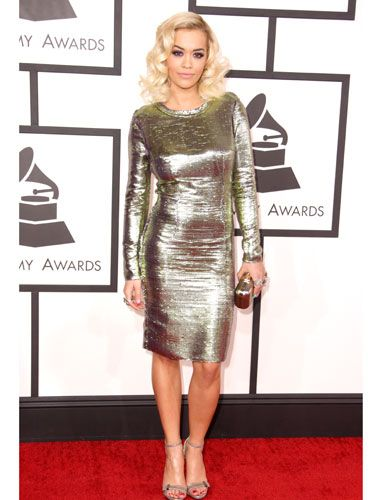 "<p>YES another star in shimmery gold! This makes us REALLY HAPPY on a red carpet. We don't know why.</p> <p><a href=""http://www.cosmopolitan.co.uk/celebs/entertainment/grammys-2014-watch-live-red-carpet-coverage"" target=""_blank"">WATCH THE 2014 GRAMMYS RED CARPET **LIVE** HERE</a></p> <p><a href=""http://www.cosmopolitan.co.uk/celebs/entertainment/celebs-at-grammy-awards-2012-entertainment"" target=""_blank"">GRAMMYS 2012: ALL THE CELEBRITIES AND A LOT OF KATY PERRY'S HAIR</a></p> <p><a href=""http://www.cosmopolitan.co.uk/fashion/news/golden-globes-red-carpet-dresses?click=main_sr"" target=""_blank"">ALL THE DRESSES AT THE 2014 GOLDEN GLOBES</a></p> <p><a href=""http://www.cosmopolitan.co.uk/fashion/news/golden-globes-2014-fashion-trends?click=main_sr"" target=""_blank"">5 HOT FASHION TRENDS ON THE GOLDEN GLOBES RED CARPET 2014</a></p>"