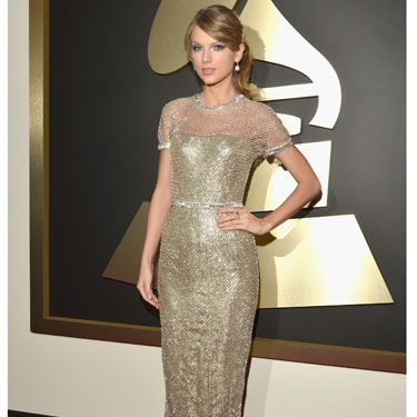 """<p>Swifty doesn't let us down and rocks up in a glittering golden dress. Some may say she plays it too safe, but she always looks classy and chic to us.</p><p>What do you reckon?</p><p><a href=""""http://www.cosmopolitan.co.uk/celebs/entertainment/grammys-2014-watch-live-red-carpet-coverage"""" target=""""_blank"""">WATCH THE 2014 GRAMMYS RED CARPET **LIVE** HERE</a></p><p><a href=""""http://www.cosmopolitan.co.uk/celebs/entertainment/celebs-at-grammy-awards-2012-entertainment"""" target=""""_blank"""">GRAMMYS 2012: ALL THE CELEBRITIES AND A LOT OF KATY PERRY'S HAIR</a></p><p><a href=""""http://www.cosmopolitan.co.uk/fashion/news/golden-globes-red-carpet-dresses?click=main_sr"""" target=""""_blank"""">ALL THE DRESSES AT THE 2014 GOLDEN GLOBES</a></p><p><a href=""""http://www.cosmopolitan.co.uk/fashion/news/golden-globes-2014-fashion-trends?click=main_sr"""" target=""""_blank"""">5 HOT FASHION TRENDS ON THE GOLDEN GLOBES RED CARPET 2014</a></p>"""