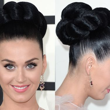 """<p>Katy's twisted mega bun was the talk of tinseltown given that it was basically the size of her head. The glass shine and impeccable symmetry also made it a masterpiece. She rightly kept her makeup simple with the focus on fluttery lashes.</p><p><a href=""""http://www.cosmopolitan.co.uk/fashion/news/grammys-2014-red-carpet-arrivals-outfits"""" target=""""_blank"""">THE GRAMMYS GOWNS, 2014</a></p><p><a href=""""http://www.cosmopolitan.co.uk/beauty-hair/news/styles/celebrity/cosmo-hairstyle-of-the-day"""" target=""""_self"""">CELEB HAIRSTYLE OF THE DAY</a></p><p><a href=""""http://www.cosmopolitan.co.uk/beauty-hair/news/styles/hair-trends-spring-summer-2014"""" target=""""_blank"""">HUGE HAIR TRENDS FOR 2014</a></p>"""