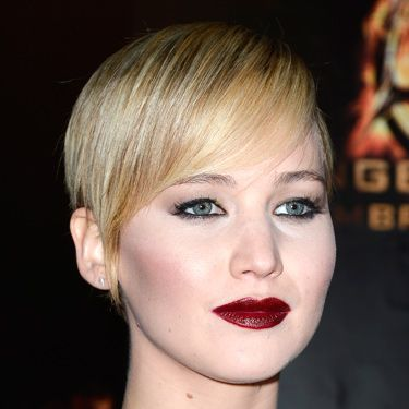 """<p>Vampy lipstick is one of this season's biggest beauty trends. Jennifer Lawrence demos how to do it with aplomb&#x3B; paired with porcelain skin and sleek hair. Try MAC's Mineralize Rich Lipstick in All Out Gorgeous (£20, <a href=""""http://www.maccosmetics.co.uk/product/shaded/168/24937/Products/Lips/Lipstick/Mineralize-Rich-Lipstick/index.tmpl"""" target=""""_blank"""">maccosmetics.co.uk</a>) to get the look.</p><p><a href=""""http://www.cosmopolitan.co.uk/beauty-hair/news/trends/beauty-products/dark-lipsticks-on-different-skin-tones-beauty-lab"""" target=""""_blank"""">DARK LIPSTICKS ON DIFFERENT SKIN TONES</a></p><p><a href=""""http://www.cosmopolitan.co.uk/beauty-hair/news/trends/celebrity-beauty/sexy-eye-makeup-ideas-celebrity-inspiration"""" target=""""_blank"""">SEXY EYE MAKEUP IDEAS</a></p><p><a href=""""http://www.cosmopolitan.co.uk/beauty-hair/news/styles/celebrity/"""" target=""""_blank"""">CELEBRITY HAIRSTYLE IDEAS</a></p>"""