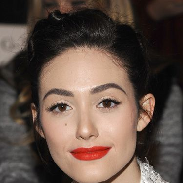 """<p>Emmy Rossum always makes inspiring makeup choices and we loved her look for the Monique Lhuillier show at <a href=""""http://www.cosmopolitan.co.uk/beauty-hair/news/trends/hair-makeup-trends-autumn-winter-2014"""" target=""""_self"""">New York Fashion Week</a>. The cat eye lashes and tomato red lipstick looked entirely the right side of retro. Try Japonesque Pro Performance Lipstick in S12, a near-exact match. £15, <a href=""""http://www.johnlewis.com/japonesque-pro-performance-lipstick/p603612?colour=S12"""" target=""""_blank"""">johnlewis.com</a></p>"""