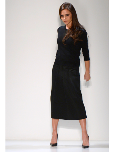 "<p>Victoria Beckham brought her Autumn/Winter 2014 collection to New York Fashion Week (with David and their too-cute kids watching from the frow), and showed how far she's come as a <em>bona fide</em> fashion designer.</p> <p>Showing looser silhouettes - but still with her trademark structure - the collection included pleated dresses and skirts, oversized coats, sleeveless jackets, slouchy trousers and - get this! - flat shoes. We know right? We told you VB's signature style has relaxed somewhat.</p> <p>With a colour palette consisting of mainly monochrome there were still plenty of surprises like punchy pops of red and gold chain details.</p> <p>""I like the element of surprise that you get with something that seems strict from the front but has a cut-away or soft, blouson back,"" said VB backstage.</p> <p>Her AW14 collection went down a storm with the assembled fash pack - though we were a tad disappointed when Victoria disn't come out and point, Spice Girl-style. Oh well, there's always next season...</p> <p><strong>CLICK THROUGH TO SEE CATWALK PICTURES >>></strong></p> <p> </p>"