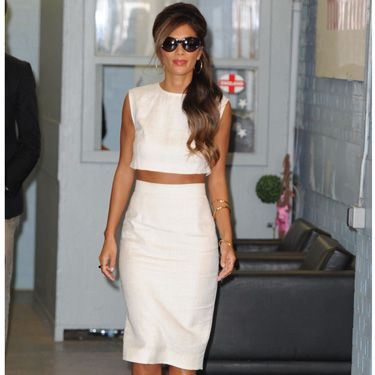 "<p><a href=""http://cosmopolitan.co.uk/fashion/news/nicole-scherzinger-x-factor-2013-earrings"" target=""_blank"">Nicole Scherzinger</a> looked wowser in her white separates at the ITV studios in London yesterday. The X Factor judge braved the autumn chill in her pencil skirt and crop top combo, which she paired with bright red Kurt Geiger pumps and cat eye sunglasses. Meow!</p>