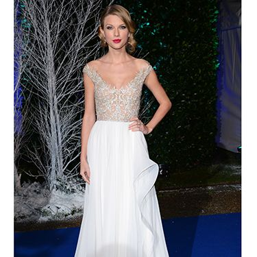 <p>Taylor Swift looked beyond amazing when she rocked up at the Winter Whites Gala in this stunning Reem Acra dress.</p>