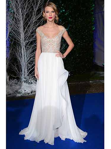 "<p>Taylor Swift looked beyond amazing when she rocked up at the Winter Whites Gala in this stunning Reem Acra dress.</p> <p>The gown featured a sheer, lace bodice and flowing cream skirt. Taylor accessorized with a sparkling Jenny Packham clutch. We love!</p> <p><a href=""http://www.cosmopolitan.co.uk/fashion/love/love-it-or-loathe-it-naomie-harries-burberry-prorsum-dress"" target=""_blank"">LOVE IT OR LOATHE IT: NAOMIE HARRIS</a></p> <p><a href=""http://www.cosmopolitan.co.uk/fashion/love/love-it-or-loathe-it-lady-gaga-jumpsuit-glasses-tokyo"" target=""_blank"">LADY GAGA'S SAFARI KHAKI</a></p> <p><a href=""http://www.cosmopolitan.co.uk/beauty-hair/news/styles/celebrity/jennifer-lawrence-best-hair-moments?page=1"" target=""_blank"">J-LAW'S VERSATILE PIXIE CUT</a></p> <p> </p>"