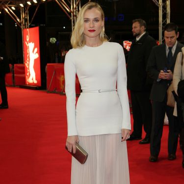 <p>Diane Kruger looked like a fashion angel in her white Elie Saab dress, complete with sexy mesh panels at the premiere of her film The Better Angels at the 2014 Berlin International Film Festival. She accessorised with a strong red lip, chic clutch and man candy, in the form of Joshua Jackson.</p>