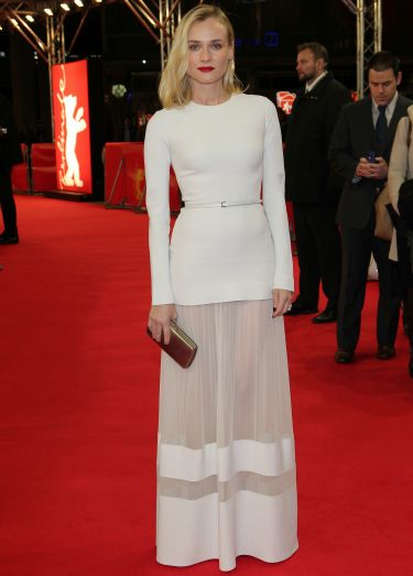 "<p>Diane Kruger looked like a fashion angel in her white Elie Saab dress, complete with sexy mesh panels at the premiere of her film The Better Angels at the 2014 Berlin International Film Festival. She accessorised with a strong red lip, chic clutch and man candy, in the form of Joshua Jackson.</p> <p><a href=""http://www.cosmopolitan.co.uk/fashion/news/oscar-nominees-luncheon-2014-red-carpet"" target=""_blank"">OSCAR NOMINEES LUNCH RED CARPET LOOKS</a></p> <p><a href=""http://www.cosmopolitan.co.uk/fashion/shopping/dress-spring-fashion-trends-2014"" target=""_blank"">12 DRESSES THAT SCREAM SPRING</a></p>"