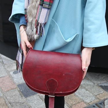 """<p>Vintage leather saddle bags are a must.</p><p><a href=""""http://www.cosmopolitan.co.uk/fashion/news/new-york-fashion-week-street-style-aw14"""" target=""""_blank"""">NEW YORK FASHION WEEK STREET STYLE</a></p><p><a href=""""http://www.cosmopolitan.co.uk/fashion/news/celebs-new-york-fashion-week-aw14"""" target=""""_blank"""">NEW YORK FASHION WEEK FROW</a></p><p><a href=""""http://www.cosmopolitan.co.uk/fashion/news/victoria-beckham-nyfw-show-2014"""" target=""""_blank"""">VICTORIA BECKHAM AW14 NYFW</a></p>"""