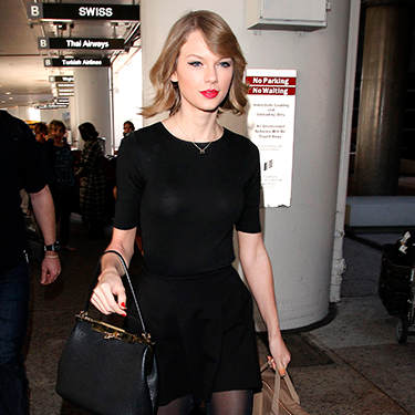 """<p>Taylor Swift CARRIED HER OWN GUITAR through the airport after flying back from her London shows, and gave us another gawp of her new bob.</p><p><a href=""""http://www.cosmopolitan.co.uk/celebs/entertainment/jennifer-lawrence-figure-skater-sochi-2014"""" target=""""_blank"""">WHAT IF JENNIFER LAWRENCE WAS AN OLYMPIC FIGURE SKATER?</a></p><p><a href=""""http://www.cosmopolitan.co.uk/fashion/love/tilda-swinton-sliders-Berlin-Grand-Budapest-Hotel"""" target=""""_blank"""">HAVE YOUR SAY ON THIS WEEK'S CELEBRITY FASHION</a></p><p><a href=""""http://www.cosmopolitan.co.uk/beauty-hair/news/styles/celebrity/cosmo-hairstyle-of-the-day"""" target=""""_blank"""">CHECK OUT COSMO'S CELEBRITY HAIRSTYLE OF THE DAY</a></p>"""