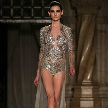 """<p>When a dress is this amazing, it doesn't matter if everyone can see your pants - especially when they're as sparkly as this particular pair of smalls...</p><p><a href=""""http://www.cosmopolitan.co.uk/fashion/news/celebs-new-york-fashion-week-aw14"""" target=""""_blank"""">CELEBRITY FASHION WEEK OUTFITS</a></p><p><a href=""""http://www.cosmopolitan.co.uk/fashion/news/london-fashion-week-street-style-aw14"""" target=""""_blank"""">LONDON FASHION WEEK STREET STYLE</a></p><p><a href=""""http://www.cosmopolitan.co.uk/fashion/shopping/mulberry-cara-delevingne-handbag-collection"""" target=""""_blank"""">MULBERRY'S CARA DELEVINGNE COLLECTION</a></p>"""