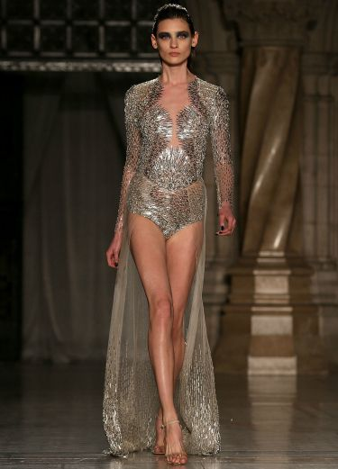 """<p>When a dress is this amazing, it doesn't matter if everyone can see your pants - especially when they're as sparkly as this particular pair of smalls...</p> <p><a href=""""http://www.cosmopolitan.co.uk/fashion/news/celebs-new-york-fashion-week-aw14"""" target=""""_blank"""">CELEBRITY FASHION WEEK OUTFITS</a></p> <p><a href=""""http://www.cosmopolitan.co.uk/fashion/news/london-fashion-week-street-style-aw14"""" target=""""_blank"""">LONDON FASHION WEEK STREET STYLE</a></p> <p><a href=""""http://www.cosmopolitan.co.uk/fashion/shopping/mulberry-cara-delevingne-handbag-collection"""" target=""""_blank"""">MULBERRY'S CARA DELEVINGNE COLLECTION</a></p>"""