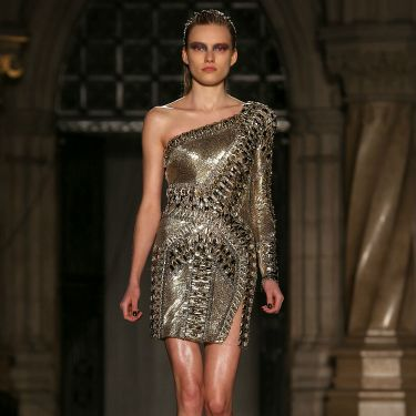 """<p>Look fierce in this heavy metal frock. And a bit like you're wearing very stylish armour, too...</p><p><a href=""""http://www.cosmopolitan.co.uk/fashion/news/celebs-new-york-fashion-week-aw14"""" target=""""_blank"""">CELEBRITY FASHION WEEK OUTFITS</a></p><p><a href=""""http://www.cosmopolitan.co.uk/fashion/news/london-fashion-week-street-style-aw14"""" target=""""_blank"""">LONDON FASHION WEEK STREET STYLE</a></p><p><a href=""""http://www.cosmopolitan.co.uk/fashion/shopping/mulberry-cara-delevingne-handbag-collection"""" target=""""_blank"""">MULBERRY'S CARA DELEVINGNE COLLECTION</a></p>"""